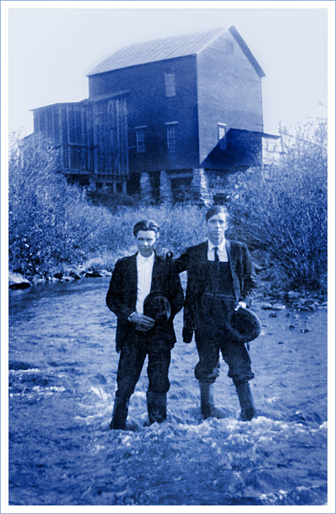 Fielden Jennings with his brother Grover in front of the grain mill on Chestnut Creek near Galax, Virginia.
