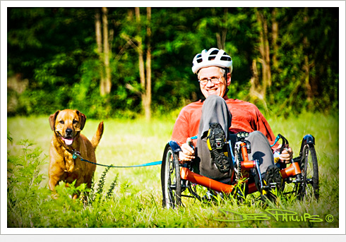Biker riding one of the lowrider bikes and his canine companion in Lewisville, North Carolina (Forsyth County). Deb Phillips, photographer.