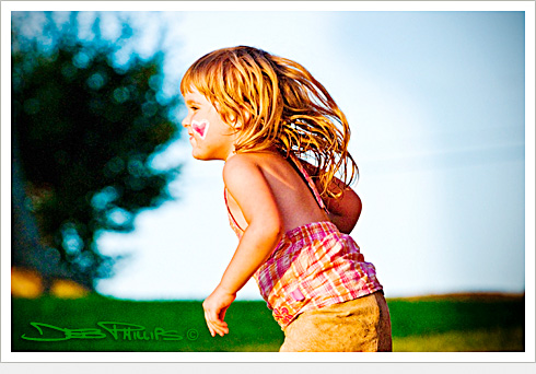 Young girl running at Shallowford Square in Lewisville, North Carolina (Forsyth County) prior to the musical, Hello Dolly, performed by the West Side Civic Theatre. Deb Phillips, photographer.