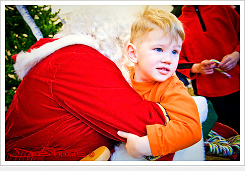 Young boy with Santa Claus at the Holiday Cheer Event held at the Lewisville, North Carolina Library (Forsyth County) - Deb Phillips, photographer.