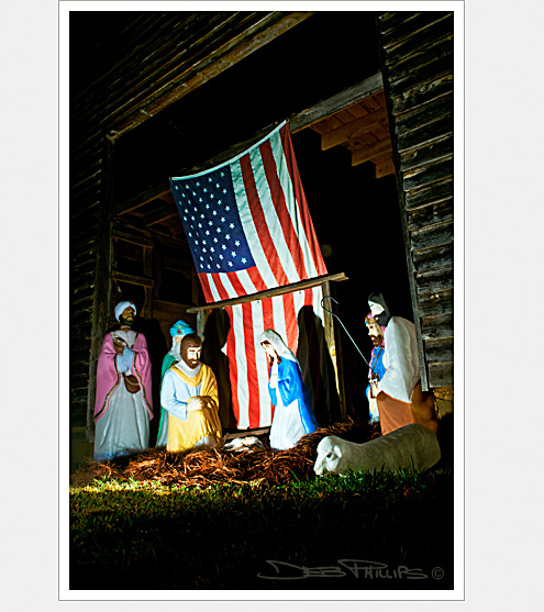 US flag and crèche at a barn in Lewisville, North Carolina (Forsyth County) at the home of the Kiger family - Deb Phillips, photographer.