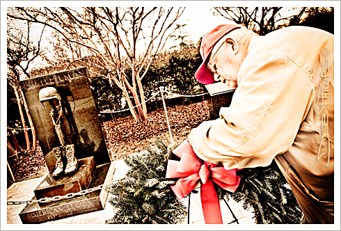 Korean War veteran, Fred O'Brien, places a wreath at the Veterans Memorial in Shallowford Square in Lewisville, North Carolina (Forsyth County). Deb Phillips, photographer.
