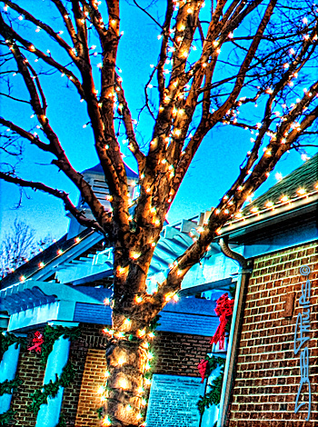 A Photo Within a Photo adapted from a wider shot of Shallowford Square with Christmas lights in Lewisville, North Carolina (Forsyth County). Deb Phillips, photographer.