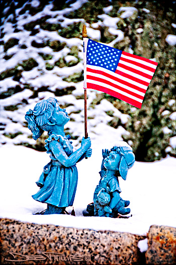 Statues of a patriotic boy and girl found in a yard in Lewisville, North Carolina (Forsyth County) - Deb Phillips, photographer.