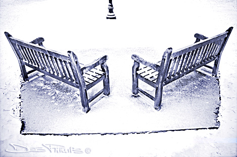 Overhead view of snow-covered benches at Shallowford Square in Lewisville, North Carolina (Forsyth County) - black-and-white shot. Deb Phillips, photographer.