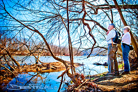 Hobie and Addie Lou Cawood are shown standing along the Yadkin River on the Yadkin County side, just south of the historic Shallow Ford, near the battlefield of Shallow Ford. Deb Phillips, photographer.