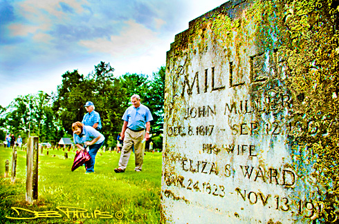 Participants in the 2009 Historic Graveyard Tour explored the graveyard at Concord United Methodist Church in Lewisille, North Carolina with church member Shelton Barefoot (right). Deb Phillips, photographer.