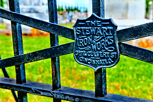 A closeup of the manufacturer's nameplate on the original pig iron fence that surrounds a small group of historic gravestones in the center of the Lewisville Baptist Church graveyard. Deb Phillips, photographer.