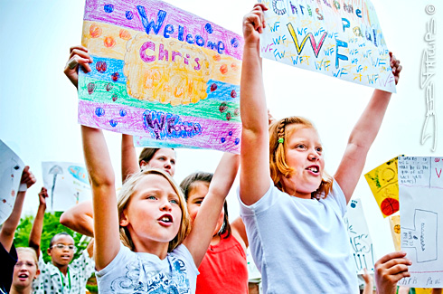 Lewisville Elementary third-graders lift their handmade signs high and chant &quot;Chris Paul! Chris Paul!&quot; for several minutes as they await Chris Paul's introduction. Deb Phillips, photographer.