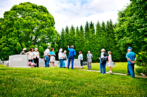 The individuals who participated in the 2009 Historic Graveyard Tour listen as Ruth Reynolds Hartle shares some history of the Lewisville United Methodist Church graveyard in Lewisville, NC (Forsyth County). Photography by Deb Phillips.