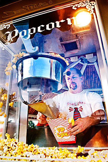Marty Myers, Lewisville's Town Planner, serves up popcorn for the Starlight Movie Night at Shallowford Square in Lewisville, NC (Forsyth County).