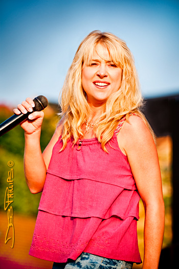 Nashville recording artist, Tammie Davis, sings in Shallowford Square in Lewisville, NC (Forsyth County), photographed by Deb Phillips.