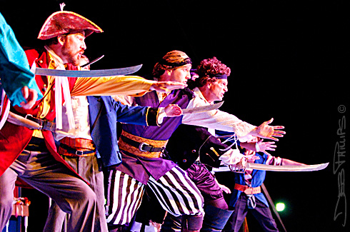 The Pirates of Penzance display their bravado and swordsmanship at Shallowford Square in Lewisville, NC.