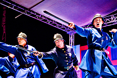 The Police Sergeant and his corp try to capture the Pirates of Penzance.