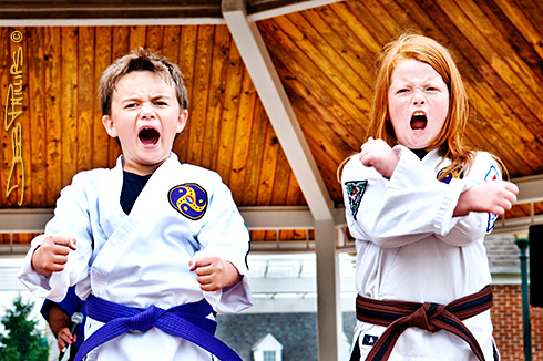 Young kids who are serious karate students