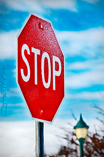 Stop sign on a snowy day at Shallowford Square in Lewisville, NC (Forsyth County).