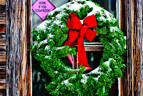 Christmas wreath hanging in the window of the original Enchanted Cottage and Scrapbook Store in Lewisville, NC (Forsyth County). Photography by Deb Phillips.