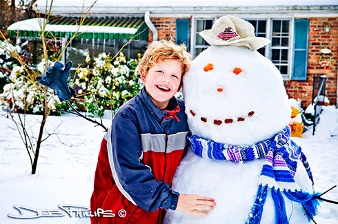 Patrick Nelson stands beside Frosty the snowman in his front yard in Lewisville, North Carolina (Forsyth County). Photographer, Deb Phillips.