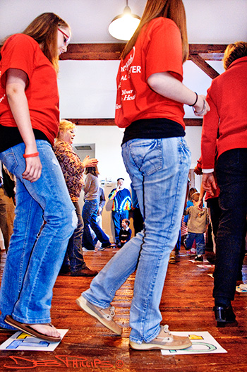 Individuals participated in a cakewalk at the 100th anniversary of Lewisville Roller Mills.